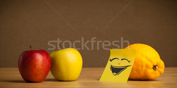 Lemon with post-it note laughing on apples Stock photo © ra2studio