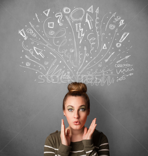 Young woman thinking with sketched arrows above her head Stock photo © ra2studio