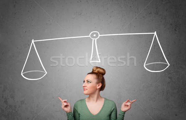 Young woman taking a decision Stock photo © ra2studio