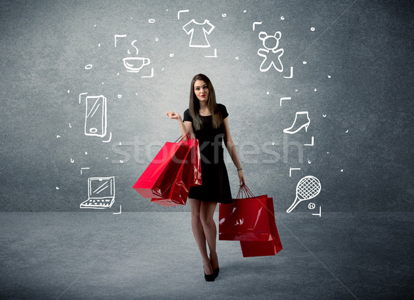 Shopping female with bags and drawn icons Stock photo © ra2studio