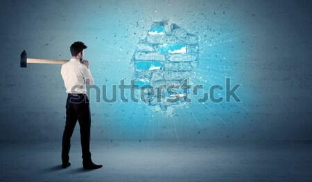 деловой человек кирпичная стена огромный молота строительство Сток-фото © ra2studio