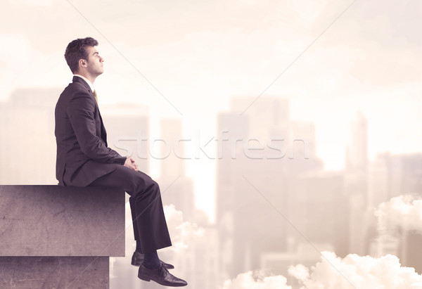 Peaceful sales guy sitting on roof top Stock photo © ra2studio
