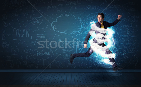 Happy business man jumping with storm cloud around him  Stock photo © ra2studio