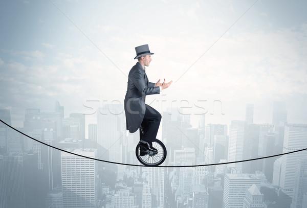 Bátor fickó lovaglás kötél fölött városkép Stock fotó © ra2studio