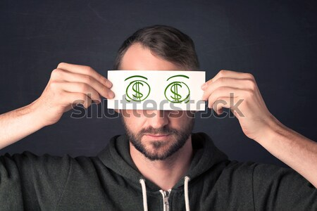 Guy halten Papier Hand gezeichnet Dollarzeichen grünen Stock foto © ra2studio