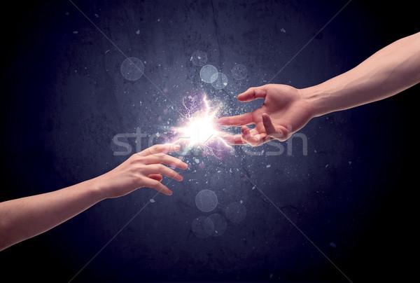 Ręce świetle iskra dwa mężczyzna inny Zdjęcia stock © ra2studio