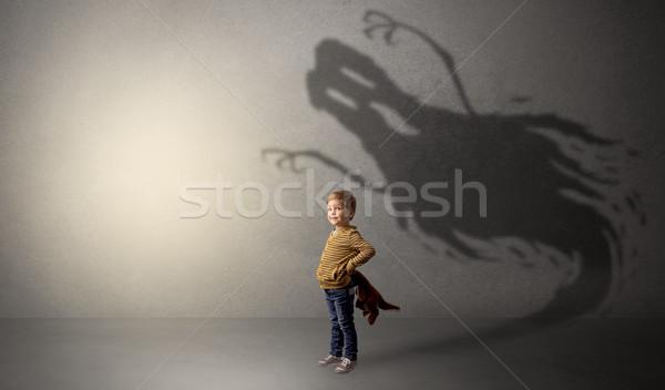 Scary ghost shadow behind kid Stock photo © ra2studio