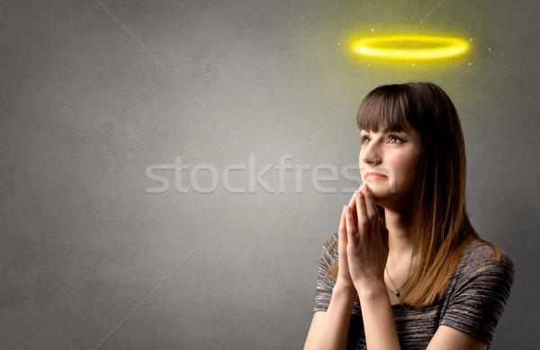 Pregando giovane ragazza grigio lucido giallo Foto d'archivio © ra2studio
