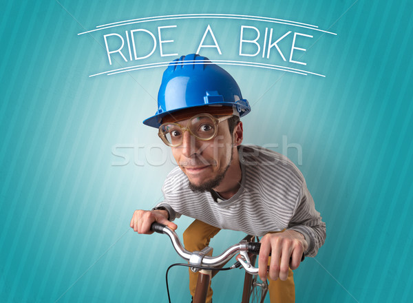 Nutty cyclist on his bike Stock photo © ra2studio