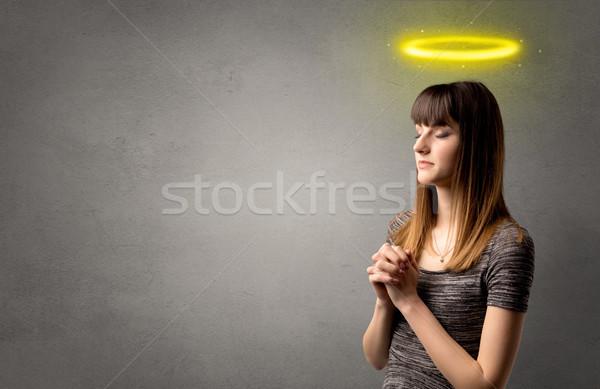 Jong meisje bidden jonge vrouw grijs Geel Stockfoto © ra2studio