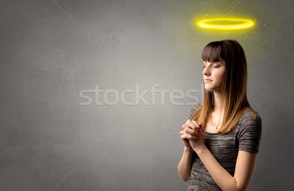 Joven rezando gris brillante amarillo Foto stock © ra2studio