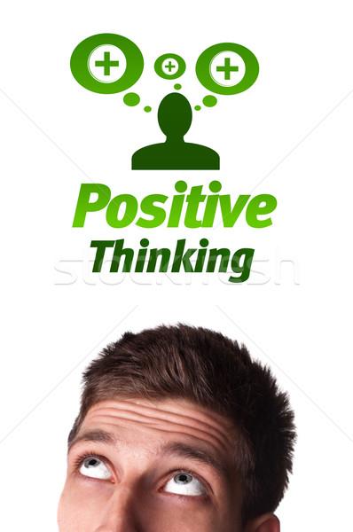 Jóvenes cabeza mirando positivo negativos signos Foto stock © ra2studio