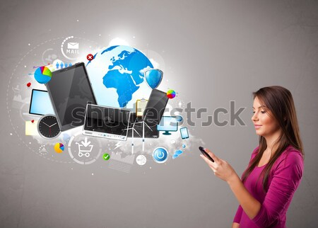 young woman standing and browsing on her phone Stock photo © ra2studio