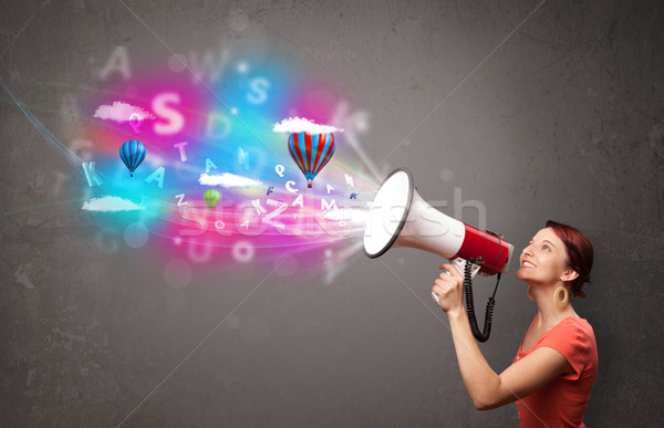 Cute girl shouting into megaphone and abstract text and balloons come out Stock photo © ra2studio