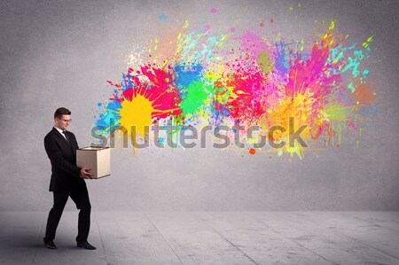 Colorful splashes are coming out of gun shaped hands Stock photo © ra2studio