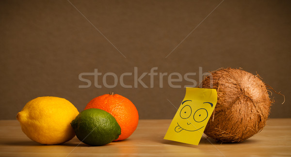 Coconut with post-it note sticking out tongue to citrus fruits Stock photo © ra2studio