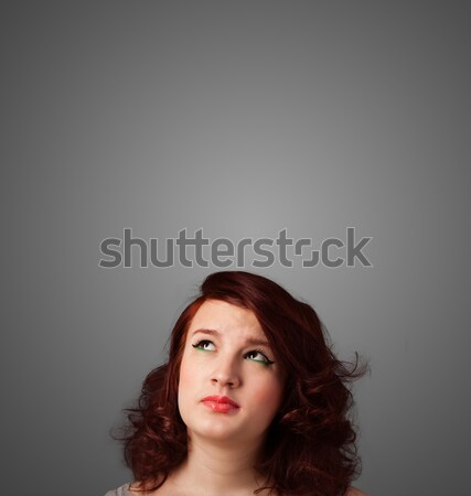 Young woman thinking with copy space Stock photo © ra2studio