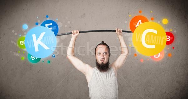Sovány fickó emel színes vitamin súlyok Stock fotó © ra2studio