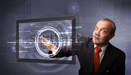 Empresário tocante moderno tecnologia comprimido em pé Foto stock © ra2studio