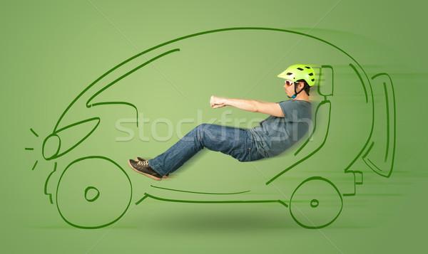 Stock photo: Man drives an eco friendy electric hand drawn car