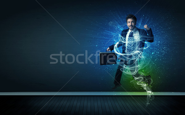 Stock photo: Talented cheerful businessman jumping with glowing energy lines