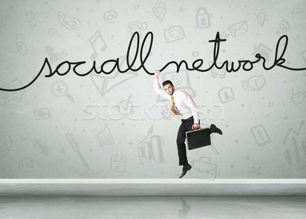Asılı işadamı sosyal ağ halat iş el Stok fotoğraf © ra2studio