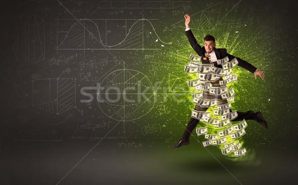 Derűs ugrik dollár bankjegyek körül pénz Stock fotó © ra2studio