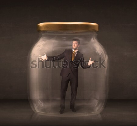 Businessman shut into a glass jar concept Stock photo © ra2studio