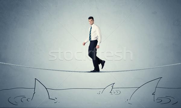 Imprenditore piedi corda sopra coraggiosi Foto d'archivio © ra2studio