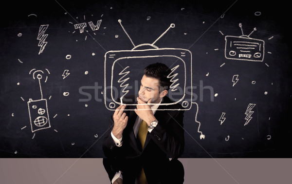 Happy businessman drawing tv and radio Stock photo © ra2studio