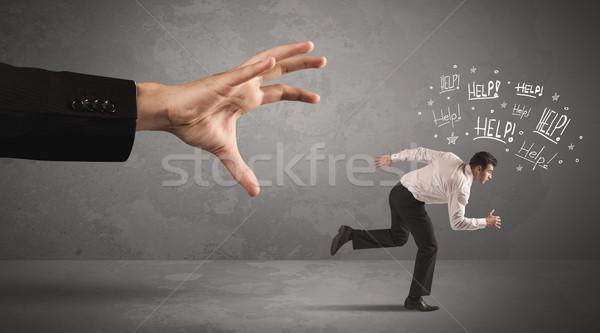 Business person running away from big hand  Stock photo © ra2studio