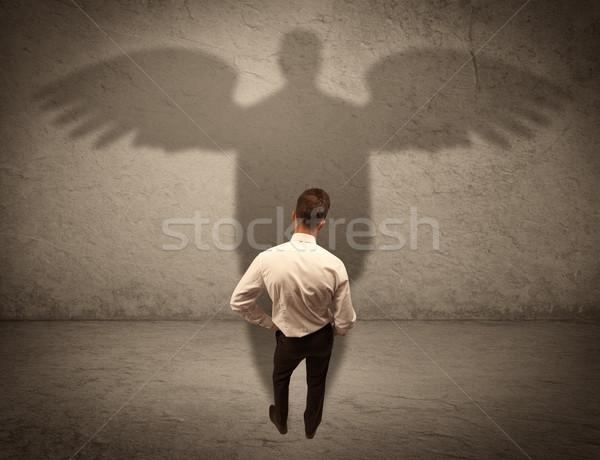 Eerlijk verkoper engel schaduw geslaagd zakenman Stockfoto © ra2studio