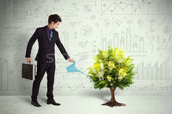 Business man pouring water on lightbulb growing tree Stock photo © ra2studio