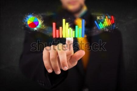Foto stock: Guapo · jóvenes · hombre · de · negocios · tocar · colorido · moderna