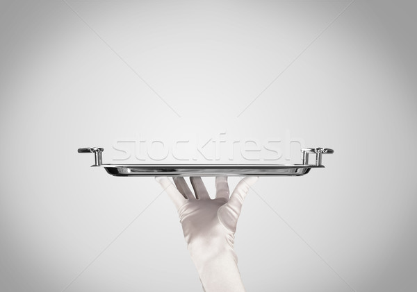 Präsentation Platte stylish Hand eleganten Kellner Stock foto © ra2studio