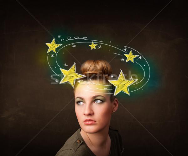 girl with yellow stars circleing around her head illustration Stock photo © ra2studio