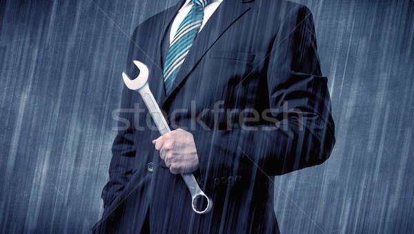 Pracodawca stałego narzędzie strony młodych przystojny mężczyzna Zdjęcia stock © ra2studio