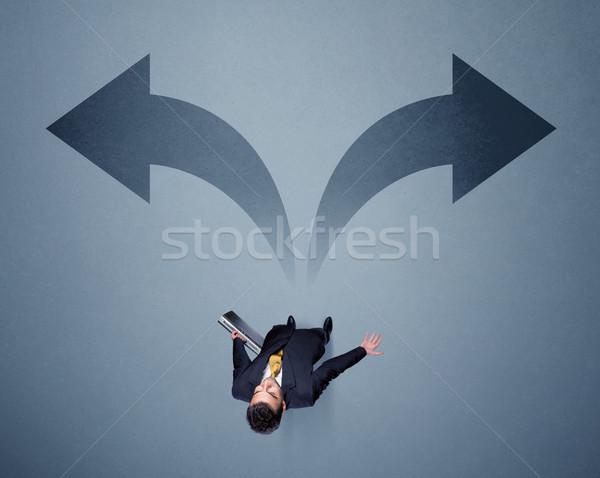 Işadamı karar genç akıllı ayakta Stok fotoğraf © ra2studio
