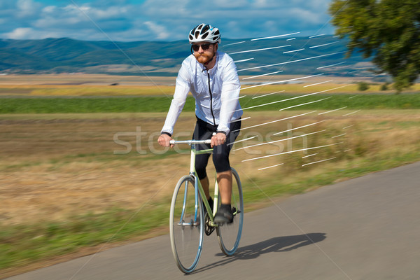 Casual cyclist riding bicycle very fast Stock photo © ra2studio