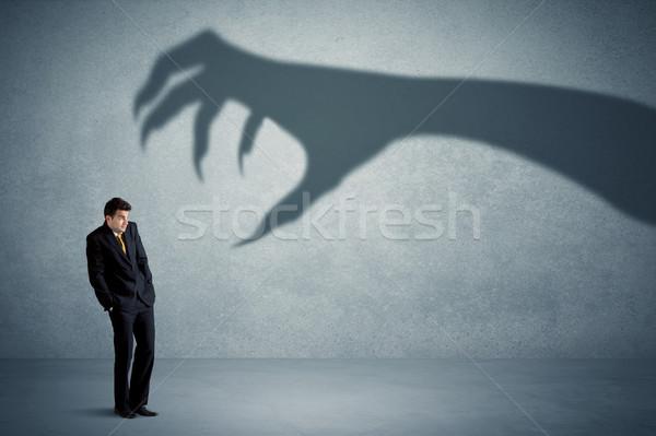 üzletember félő nagy szörny karom árnyék Stock fotó © ra2studio