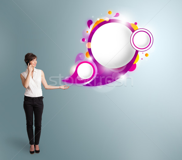 Pretty young woman presenting abstract speech bubble copy space and making phone call Stock photo © ra2studio