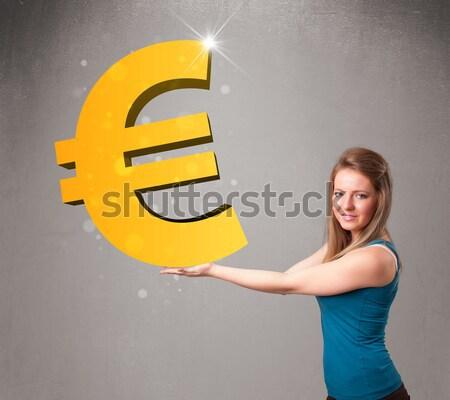 Schöne Mädchen halten groß 3D Gold Euro Stock foto © ra2studio