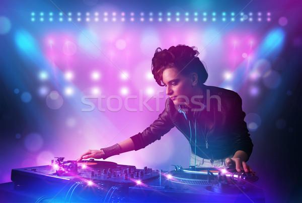Csinos fiatal dídzsé zene lemezjátszók színpad Stock fotó © ra2studio