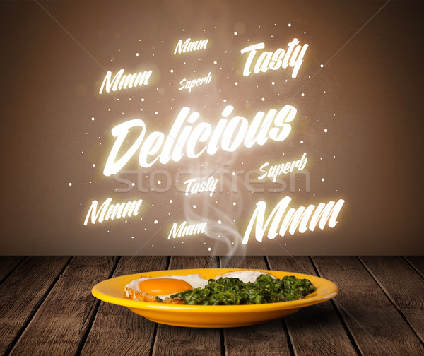 Food plate with delicious and tasty glowing writings Stock photo © ra2studio
