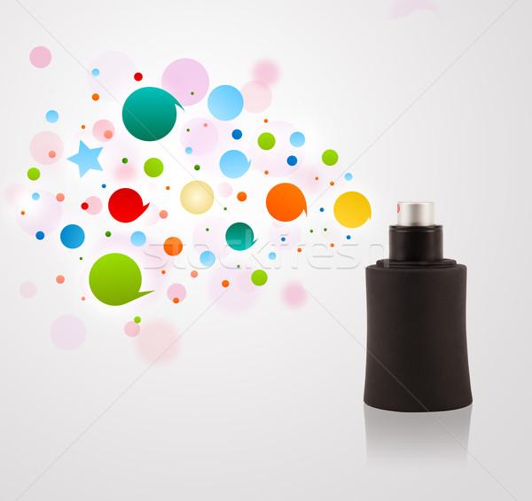 Perfume bottle spraying colored bubbles Stock photo © ra2studio