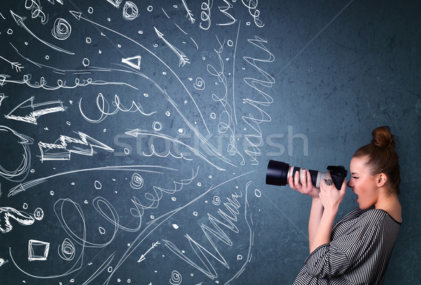 Photographer shooting images while energetic hand drawn lines an Stock photo © ra2studio