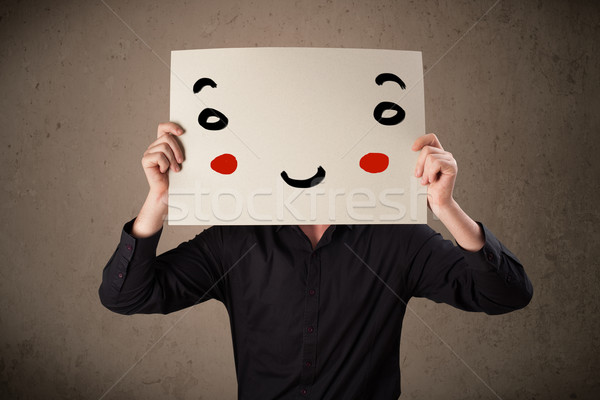Empresário cartão rosto sorridente jovem mão Foto stock © ra2studio