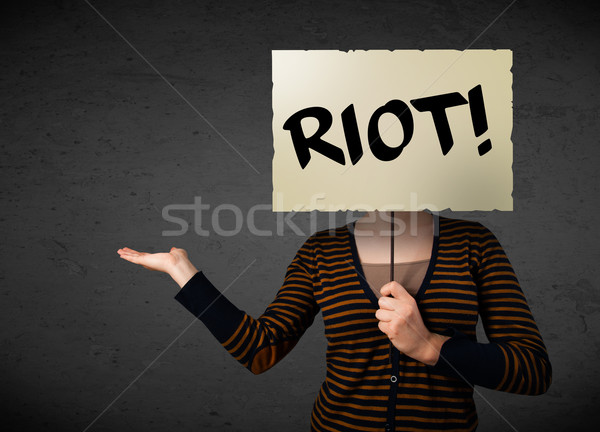 Young woman holding a protest sign Stock photo © ra2studio