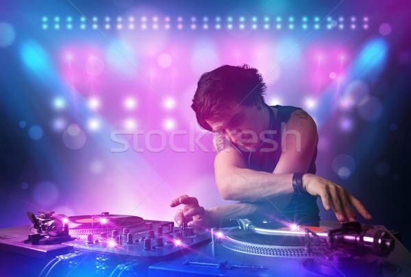 Diskjokey müzik turntable sahne ışıklar genç Stok fotoğraf © ra2studio