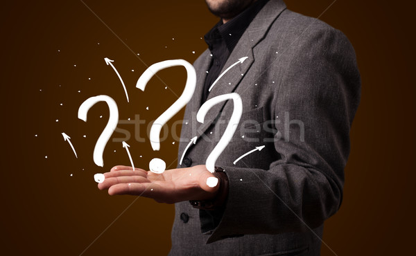 Stockfoto: Jonge · zakenman · presenteren · vraagtekens · zakenman
